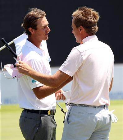CASARES, SPAIN - MAY 22:  Ian Poulter of England is congratulated by Nicolas Colsaerts of Belgium on the first extra hole during the semi-final of the Volvo World Match Play Championship at Finca Cortesin on May 22, 2011 in Casares, Spain.  (Photo by Ross Kinnaird/Getty Images)