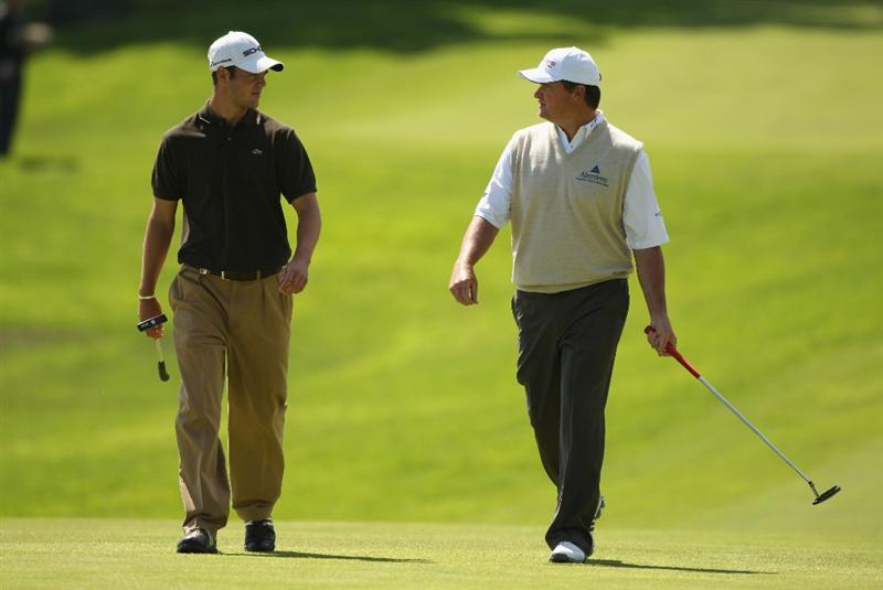 LUSS, UNITED KINGDOM - JULY 10:  Martin Kaymer of Germany chats with Paul Lawrie (R) of Scotland on the 7th green during the Second Round of The Barclays Scottish Open at Loch Lomond Golf Club on July 10, 2009 in Luss, Scotland. (Photo by Warren Little/Getty Images)