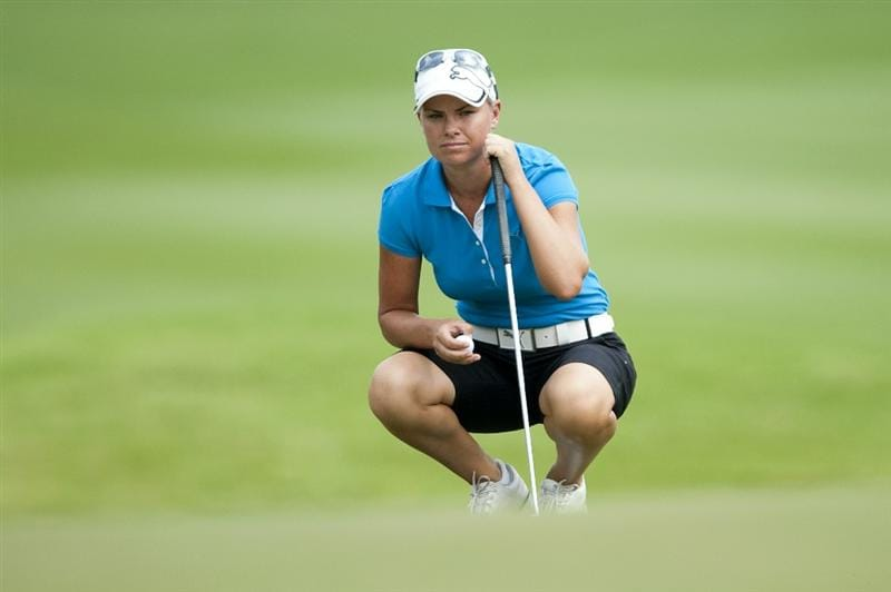CHON BURI, THAILAND - FEBRUARY 18:  Lee-Anne Pace of South Africa lines up a putt on the 1st green during day two of the LPGA Thailand at Siam Country Club on February 18, 2011 in Chon Buri, Thailand.  (Photo by Victor Fraile/Getty Images)