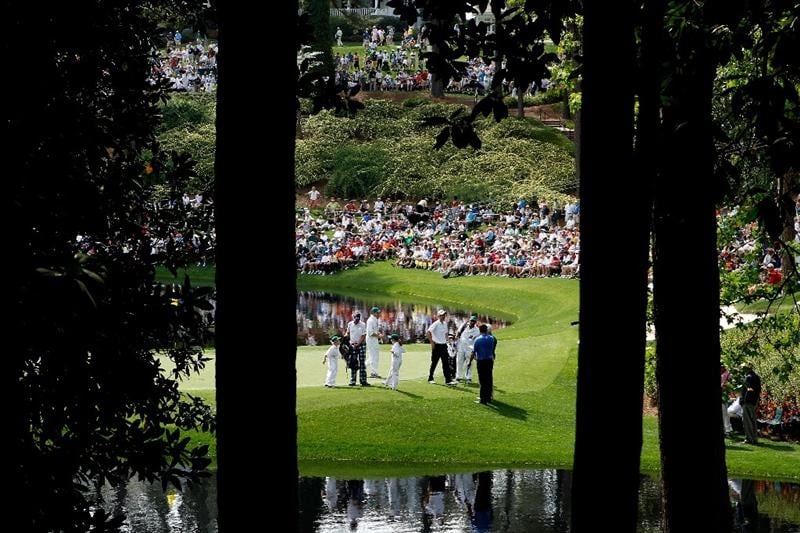 AUGUSTA, GA - APRIL 07:  Ian Poulter of England, Ross Fisher of England and Nick Faldo of England are seen with their caddies on a green during the Par 3 Contest prior to the 2010 Masters Tournament at Augusta National Golf Club on April 7, 2010 in Augusta, Georgia.  (Photo by David Cannon/Getty Images)