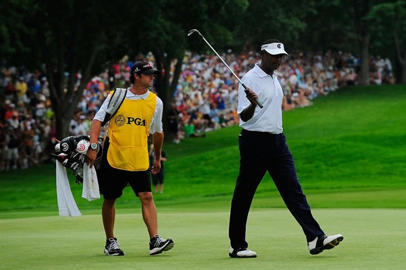 CHASKA, MN - AUGUST 15:  Vijay Singh of Fiji (R) celebrates an eagle putt on the seventh green alongside his caddie Chad Reynolds during the third round of the 91st PGA Championship at Hazeltine National Golf Club on August 15, 2009 in Chaska, Minnesota.  (Photo by Sam Greenwood/Getty Images)