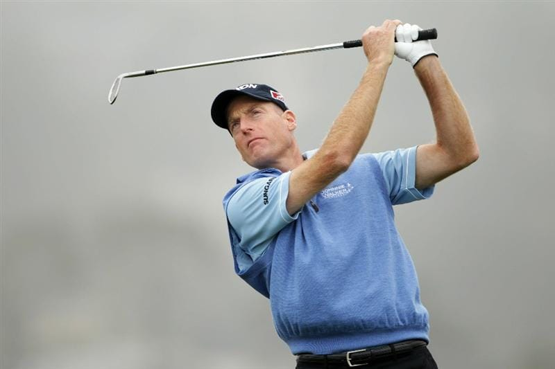 PEBBLE BEACH, CA - JUNE 14:  Jim Furyk watches a tee shot during a practice round prior to the start of the 110th U.S. Open at Pebble Beach Golf Links on June 14, 2010 in Pebble Beach, California.  (Photo by Andrew Redington/Getty Images)