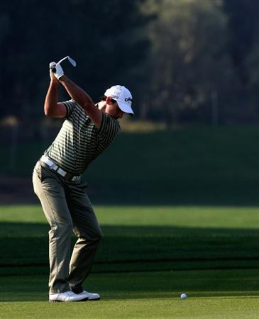 DOHA, QATAR - JANUARY 22:  Oliver Wilson of England plays his second shot on the par four 11th hole during the first round of the Commercialbank Qatar Masters at the Doha Golf Club on January 22, 2009 in Doha, Qatar.  (Photo by Ross Kinnaird/Getty Images)