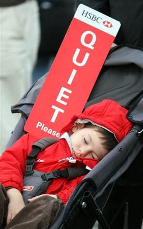 SHANGHAI, CHINA - NOVEMBER 09:  A young golf fan sleeps during the forth round of the HSBC Champions at Sheshan Golf Club on November 9, 2008 in Shanghai, China.  (Photo by Ross Kinnaird/Getty Images)