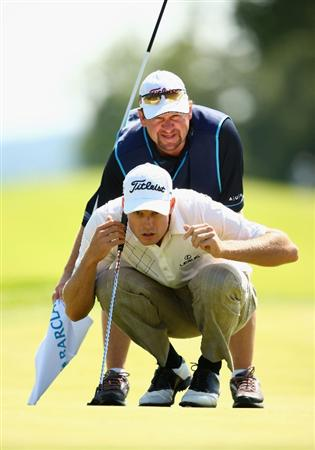 LUSS, UNITED KINGDOM - JULY 11:  Nick Watney of USA lines up a putt with his caddy during the Third Round of The Barclays Scottish Open at Loch Lomond Golf Club on July 11, 2009 in Luss, Scotland. (Photo by Richard Heathcote/Getty Images)