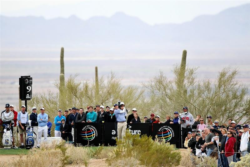 MARANA, AZ - FEBRUARY 26:  Matt Kuchar hits his tee shot on the ninth hole as Luke Donald of England looks on during the semifinal round of the Accenture Match Play Championship at the Ritz-Carlton Golf Club on February 26, 2011 in Marana, Arizona.  (Photo by Andy Lyons/Getty Images)