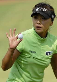 SOUTHERN PINES, NC - JUNE 29:  Mi Hyun Kim of South Korea acknowledges the gallery after finishing on the 3rd green during round two of the U.S. Women's Open Championship at Pine Needles Lodge & Golf Club June 29, 2007 in Southern Pines, North Carolina.  (Photo by Jonathan Ernst/Getty Images)