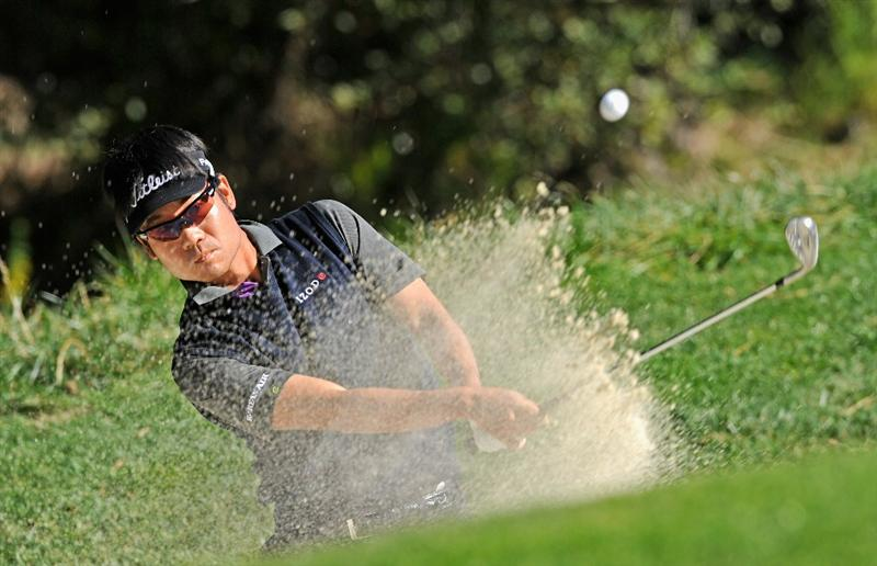 PEBBLE BEACH, CA - FEBRUARY 12:  Kevin Na plays his bunker shot on the 16th hole during the third round of the AT&T Pebble Beach National Pro-Am at the Spyglass Hil Golf Course on February 11, 2011  in Pebble Beach, California  (Photo by Stuart Franklin/Getty Images)