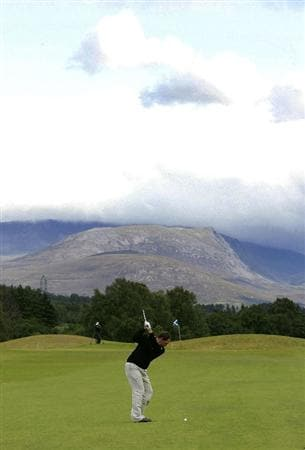 INVERNESS, SCOTLAND - AUGUST 01: Jamie McLeary of Scotland takes a shot from 18th fairway during the Scottish Hydro Challenge at the Macdonald Spey Valley Golf Course on August 01, 2009 in Inverness, Scotland. (Photo by Tom Dulat/Getty Images)