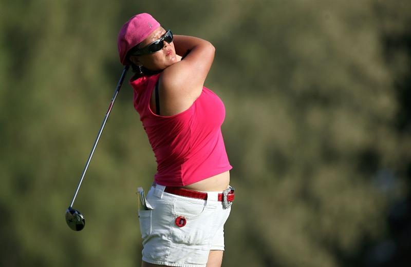 KAHUKU, HI - FEBRUARY 12:  Christina Kim hits her tee shot on the 16th hole during the first round of the SBS Open on February 12, 2009  at the Turtle Bay Resort in Kahuku, Hawaii.  (Photo by Andy Lyons/Getty Images)