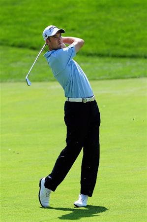 CHASKA, MN - AUGUST 14:  Ross Fisher of England watches his approach shot on the seventh hole during the second round of the 91st PGA Championship at Hazeltine National Golf Club on August 14, 2009 in Chaska, Minnesota.  (Photo by Stuart Franklin/Getty Images)