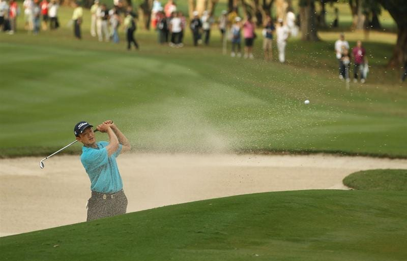 HONG KONG - NOVEMBER 21:  Anthony Kang of the USA hits out of a bunker during day four of the UBS Hong Kong Open at The Hong Kong Golf Club on November 21, 2010 in Hong Kong.  (Photo by Ian Walton/Getty Images)