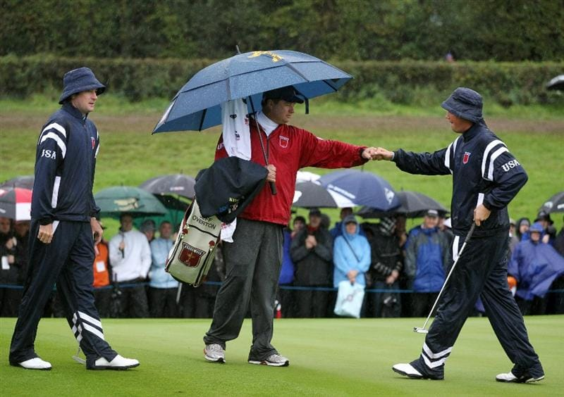 NEWPORT, WALES - OCTOBER 01:  Jeff Overton of the USA celebrates a birdie on the first green with his caddie Eric Larson as Bubba Watson looks on during the Morning Fourball Matches during the 2010 Ryder Cup at the Celtic Manor Resort on October 1, 2010 in Newport, Wales.  (Photo by Jamie Squire/Getty Images)