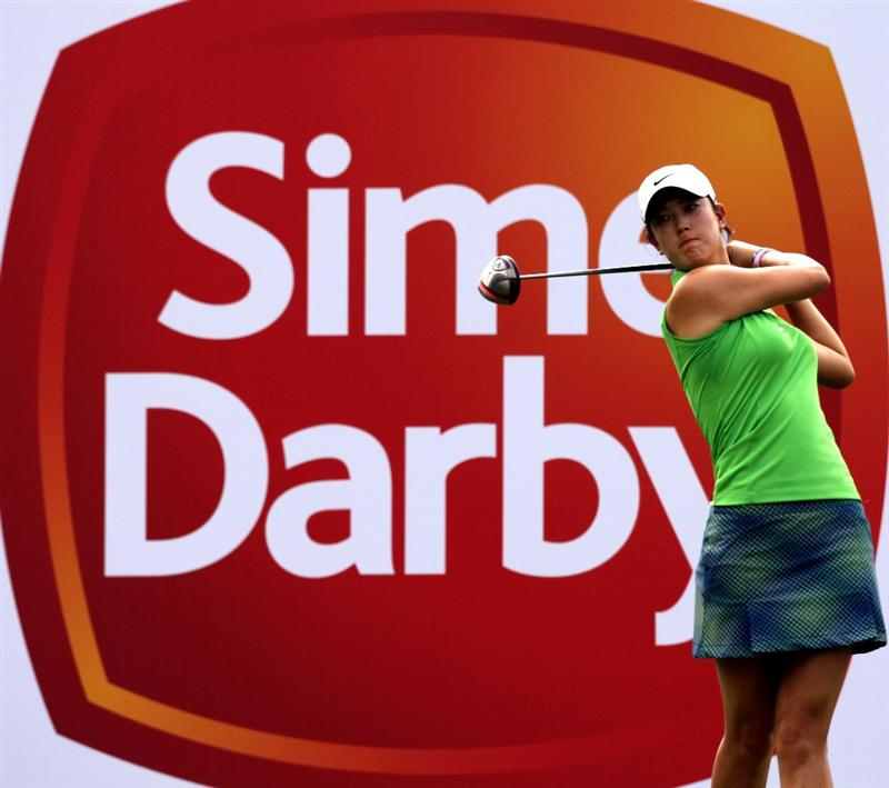 KUALA LUMPUR, MALAYSIA - OCTOBER 21:  Michelle Wie of USA tees off on the 9th hole during the Sime Darby Pro-Am at the KLGCC Golf Course on October 21, 2010 in Kuala Lumpur, Malaysia.  (Photo by Stanley Chou/Getty Images)