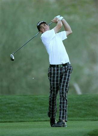 LA QUINTA, CA - JANUARY 22:  Keegan Bradley hits his tee shot on the 18th hole during round four of the Bob Hope Classic at Silver Rock Resort on January 22, 2011 in La Quinta, California.  (Photo by Stephen Dunn/Getty Images)