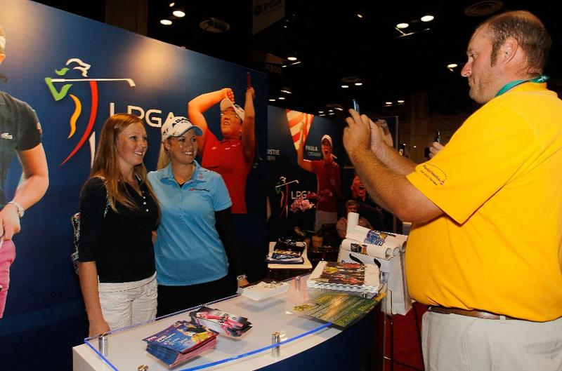 ORLANDO, FL - JANUARY 30:  LPGA player Brittany Lincicome poses for fans at the LPGA booth at the 2010 PGA Merchandise Show at the Orange County Convention Center on January 30, 2010 in Orlando, Florida.  (Photo by Scott Halleran/Getty Images)