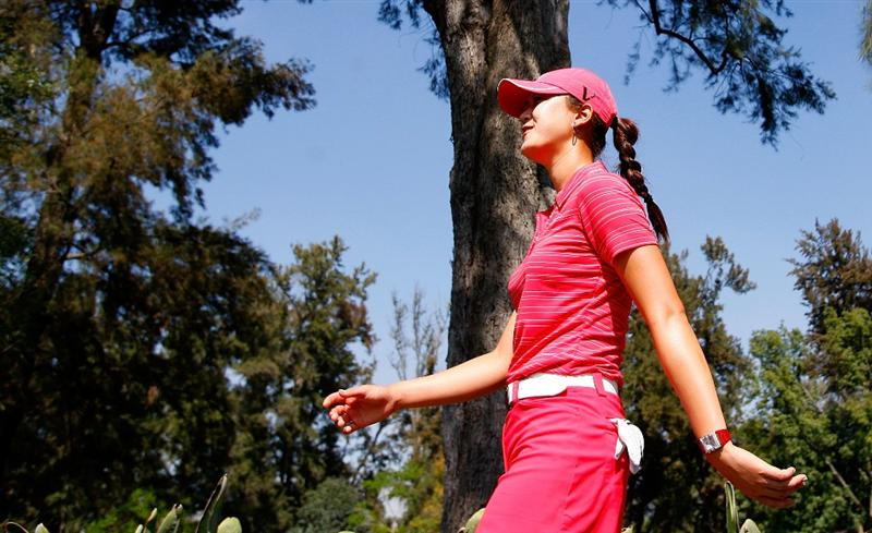 GUADALAJARA, MEXICO - NOVEMBER 15:  Michelle Wie of the United States walks down the second hole during the final round of the Lorena Ochoa Invitational Presented by Banamex and Corona at Guadalajara Country Club on November 15, 2009 in Guadalajara, Mexico.  (Photo by Kevin C. Cox/Getty Images)