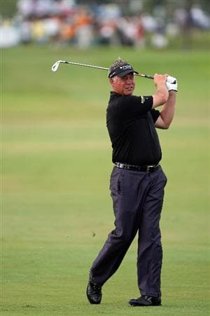 DORAL, FL - MARCH 13:  Darren Clarke of Northern Ireland plays his second shot at the 18th hole during the second round of the World Golf Championships-CA Championship at the Doral Golf Resort & Spa on March 13, 2009 in Miami, Florida  (Photo by David Cannon/Getty Images)