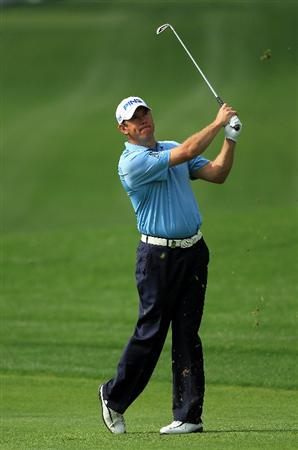 DUBAI, UNITED ARAB EMIRATES - FEBRUARY 11:  Lee Westwood of England plays his second shot at the 1st hole during the second round of the 2011 Omega Dubai Desert Classic on the Majilis Course at the Emirates Golf Club on February 11, 2011 in Dubai, United Arab Emirates.  (Photo by David Cannon/Getty Images)