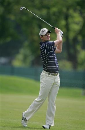 CROMWELL, CT - JUNE 26:  Justin Rose of England hits a fairway shot on the seventh hole during the third round of the Travelers Championship held at TPC River Highlands on June 26, 2010 in Cromwell, Connecticut.  (Photo by Michael Cohen/Getty Images)