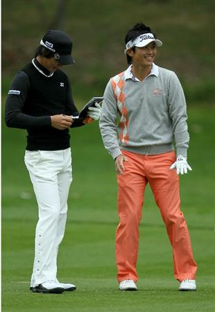 PACIFIC PALISADES, CA - FEBRUARY 18:  Ryo Ishikawa (L) and Ryuji Imada of Japan laugh on the 12th hole during round two of the Northern Trust Open at Riviera Country Club on February 18, 2011 in Pacific Palisades, California.  (Photo by Stephen Dunn/Getty Images)