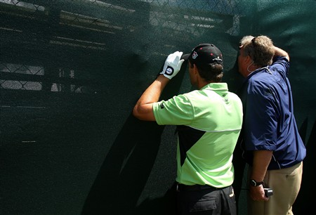 BLOOMFIELD HILLS, MI - AUGUST 08:  (L-R) Padraig Harrington of Ireland and an official look through a fence for Harrington's ball on the eighth hole during round two of the 90th PGA Championship at Oakland Hills Country Club on August 8, 2008 in Bloomfield Township, Michigan.  (Photo by Stuart Franklin/Getty Images)