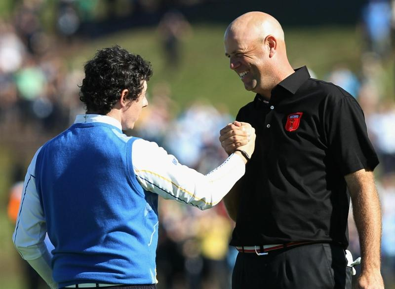 NEWPORT, WALES - OCTOBER 04:  Rory McIlroy of Europe shakes hands with Stewart Cink (R) of the USA on the 18th green after they halved their match in the singles matches during the 2010 Ryder Cup at the Celtic Manor Resort on October 4, 2010 in Newport, Wales.  (Photo by Ross Kinnaird/Getty Images)