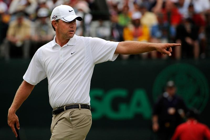 FARMINGDALE, NY - JUNE 22:  Lucas Glover walks across the 18th green during the continuation of the final round of the 109th U.S. Open on the Black Course at Bethpage State Park on June 22, 2009 in Farmingdale, New York.  (Photo by Sam Greenwood/Getty Images)