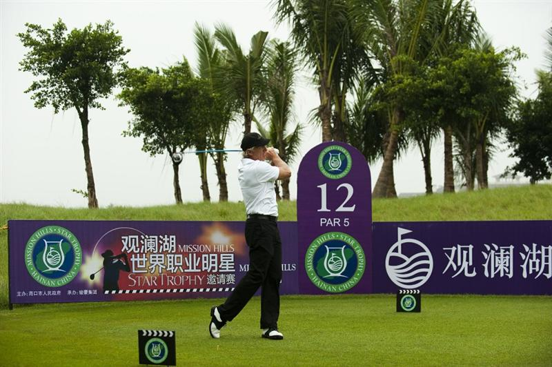 HAIKOU, CHINA - OCTOBER 27:  Golf legend Greg Norman plays a shot ahead of the inaugural Mission Hills Star Trophy on October 27, 2010 in Haikou, China.  The Mission Hills Star Trophy is Asia's leading leisure liflestyle event and features Hollywood celebrities and international golf stars.  (Photo by Victor Fraile/Getty Images)