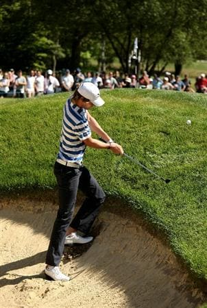 VIRGINIA WATER, ENGLAND - MAY 23:  Chris Wood of England hits to the 4th green during the final round of the BMW PGA Championship on the West Course at Wentworth on May 23, 2010 in Virginia Water, England.  (Photo by Richard Heathcote/Getty Images)