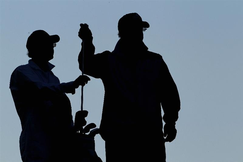 AUGUSTA, GA - APRIL 09:  Sandy Lyle of Scotland pulls a club as his caddie Ken Martin looks on during the second round of the 2010 Masters Tournament at Augusta National Golf Club on April 9, 2010 in Augusta, Georgia.  (Photo by Jamie Squire/Getty Images)