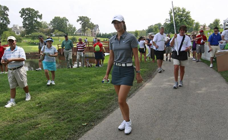 ROGERS, AR - SEPTEMBER 11:  Michelle Wie walks to the 16th tee during first round play in the P&G Beauty NW Arkansas Championship at the Pinnacle Country Club on September 11, 2009 in Rogers, Arkansas.  (Photo by Dave Martin/Getty Images)