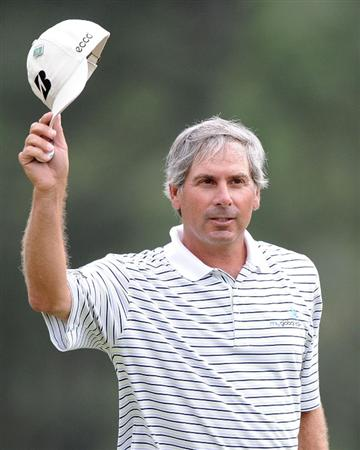 AUGUSTA, GA - APRIL 08:  Fred Couples walks off the 18th green after a six-under par 66 during the first round of the 2010 Masters Tournament at Augusta National Golf Club on April 8, 2010 in Augusta, Georgia.  (Photo by Harry How/Getty Images)