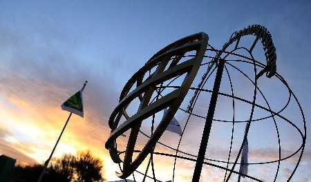 MARANA, AZ - FEBRUARY 20:  The sun rises behind a WGC orb during the first-round matches of the WGC-Accenture Match Play Championship at The Gallery Golf Club at Dove Mountain on February 20, 2008 in Marana, Arizona.  (Photo by Scott Halleran/Getty Images)