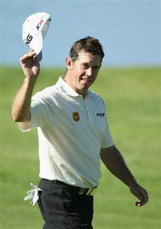 SUN CITY, SOUTH AFRICA - DECEMBER 05:  Lee Westwood of England acknowledges the crowd as he appraoches the 18th green en route to winning the 2010 Nedbank Golf Challenge with a score of -17 at the Gary Player Country Club Course  on December 5, 2010 in Sun City, South Africa.  (Photo by Warren Little/Getty Images)