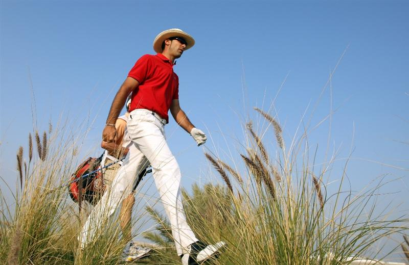 DOHA, QATAR - JANUARY 25:  Alvaro Quiros of Spain makes his way off of the 16th tee during the final round of the Commercialbank Qatar Masters at the Doha Golf Club on January 25,2009 in Doha, Qatar.  (Photo by Ross Kinnaird/Getty Images)