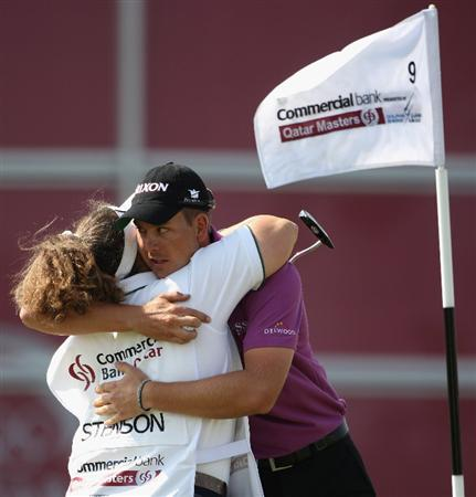 DOHA, QATAR - JANUARY 22:  Henrik Stenson of Sweden hugs his caddie Fanny Sunesson of Sweden on the ninth hole during the first round of  the Commercialbank Qatar Masters at Doha Golf Club on January 22, 2009 in Doha, Qatar.  (Photo by Andrew Redington/Getty Images)