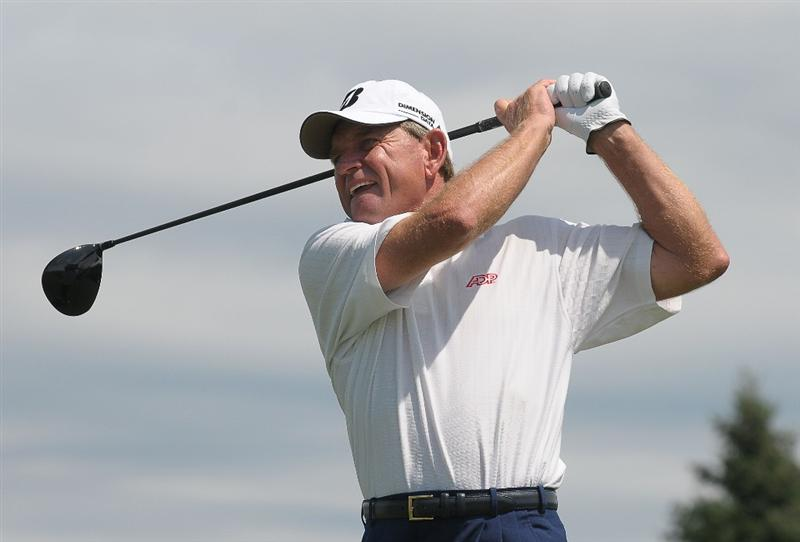 BLAINE, MN - JULY 12:  Nick Price of South Africa tees off the 1st hole during the third and final  round of the 3M Championship held at the TPC Twin Cities on July 12, 2009 in Blaine, Minnesota. (Photo by Marc Feldman/Getty Images)
