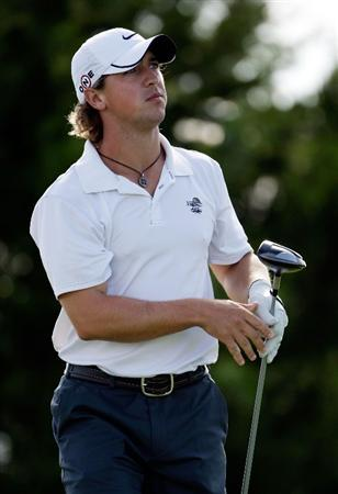 OVERLAND PARK, KS - AUGUST 20:  Garrett Osborn of the U.S. hits his tee shot on the 11th hole during the first round of the Nationwide Tour Christmas in October Classic on August 20, 2009 at Lions Gate Golf Club in Overland Park, Kansas. Osborn finished the day at 6-under-par in a three-way tie for third place.  (Photo by Jamie Squire/Getty Images)