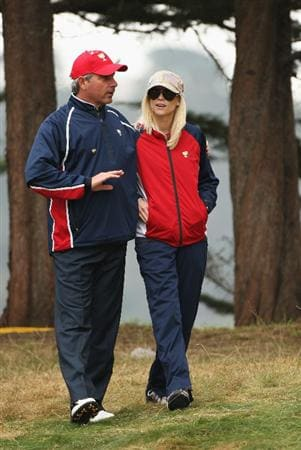 SAN FRANCISCO - OCTOBER 11:  Fred Couples, Captain of the USA Team hugs Elin Woods during the Day Four Singles Matches of The Presidents Cup at Harding Park Golf Course on October 11, 2009 in San Francisco, California.  (Photo by Warren Little/Getty Images)