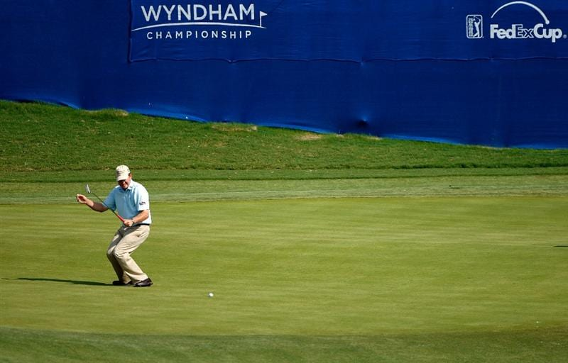 GREENSBORO, NC - AUGUST 23:  Jason Bohn reacts to missing a putt on the 16th hole during the final round of the Wyndham Championship at Sedgefield Country Club on August 23, 2009 in Greensboro, North Carolina.  (Photo by Streeter Lecka/Getty Images)