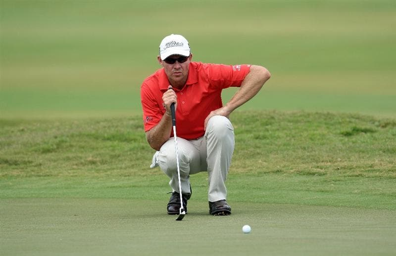 DORAL, FL - MARCH 12:  James Kingston of South Africa putts for birdie at the 17th hole during the first round of the World Golf Championships-CA Championship at the Doral Golf Resort & Spa on March 12, 2009 in Miami, Florida  (Photo by David Cannon/Getty Images)