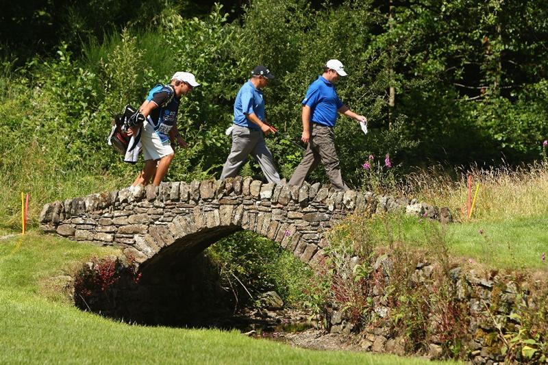 LUSS, SCOTLAND - JULY 10:  Marcus Fraser and Peter O'Malley of Australia cross a bridge on the 16th hole during the Second Round of The Barclays Scottish Open at Loch Lomond Golf Club on July 10, 2009 in Luss, Scotland.  (Photo by Richard Heathcote/Getty Images)
