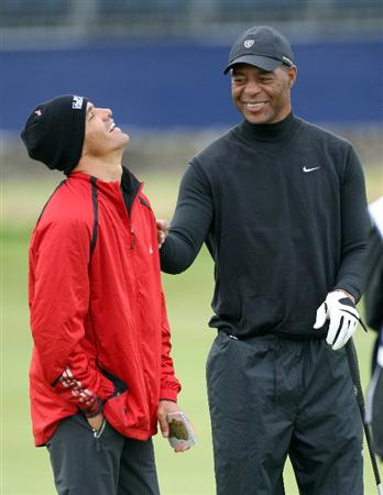 ST.ANDREWS, SCOTLAND - OCTOBER 02:  American football legend Marcus Allen shares a joke with Kelly Slater during the second round of The Alfred Dunhill Links Championship at The Old Course on October 2, 2009 in St. Andrews, Scotland.  (Photo by David Cannon/Getty Images)
