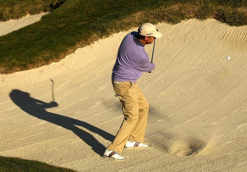 PEBBLE BEACH, CA - FEBRUARY 12:  Davis Love III hits out of the bunker on the first hole during the third round of the AT&T Pebble Beach National Pro-Am at the Pebble Beach Golf Links on February 12, 2011 in Pebble Beach, California  (Photo by Ezra Shaw/Getty Images)