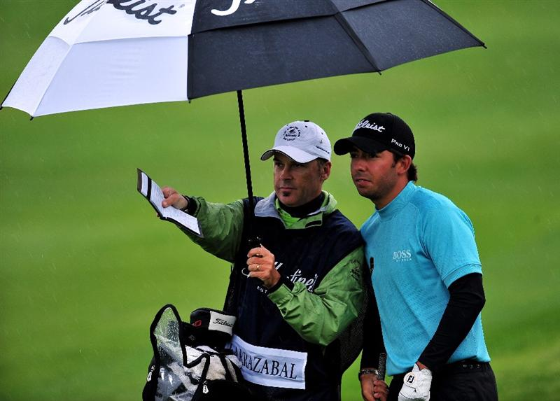 JEJU, SOUTH KOREA - APRIL 24:  Pablo Larrazabal of Spain and caddie Rod Gutry during the second round of the Ballantine's Championship at Pinx Golf Club on April 24, 2009 in Jeju, South Korea.  (Photo by Stuart Franklin/Getty Images)