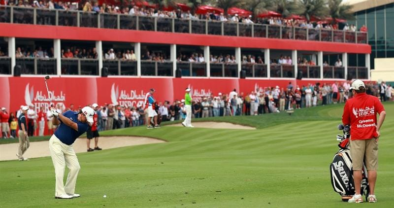 ABU DHABI, UNITED ARAB EMIRATES - JANUARY 22:  Graeme McDowell of Northern Ireland playing his third shot at the 18th hole during the third round of the 2011 Abu Dhabi HSBC Golf Championship held at the Abu Dhabi Golf Club on January 22, 2011 in Abu Dhabi, United Arab Emirates.  (Photo by David Cannon/Getty Images)