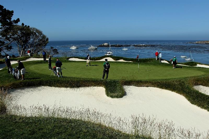 PEBBLE BEACH, CA - JUNE 16:  Golfers practice on the fourth green during a practice round prior to the start of the 110th U.S. Open at Pebble Beach Golf Links on June 16, 2010 in Pebble Beach, California.  (Photo by Andrew Redington/Getty Images)