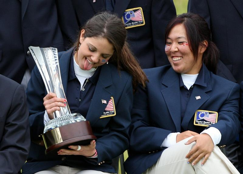 GLENEAGLES, SCOTLAND - SEPTEMBER 28:  Emma Talley (L) and Cassy Isagawa of the victorious USA team celebrate with the trophy at the end of the second day of play at the Junior Ryder Cup at Gleneagles on September 28 2010 near Muirton, Scotland. (Photo by Ian MacNicol/Getty Images)