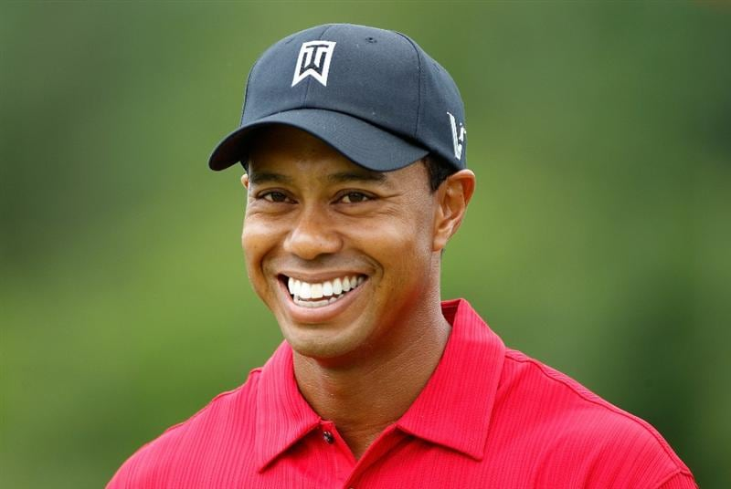 DUBLIN, OH - JUNE 06:  Tiger Woods smiles as he walks to the first tee during the final round of the Memorial Tournament presented by Morgan Stanley at Muirfield Village Golf Club on June 6, 2010 in Dublin, Ohio.  (Photo by Scott Halleran/Getty Images)